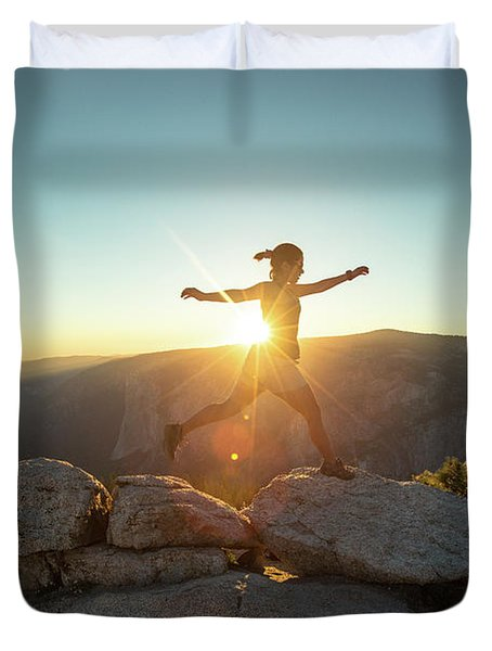 Person Leaping Along Rocks At Sunset Duvet Cover