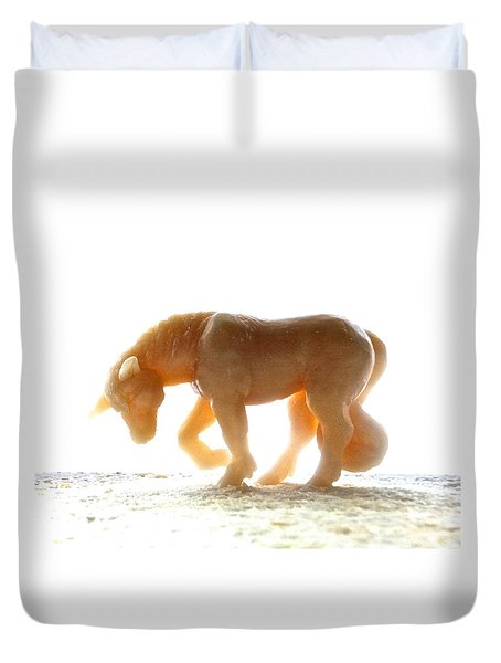 Duvet Cover featuring the photograph Petite Licorne Doree Baignee De Lumiere by Marc Philippe Joly