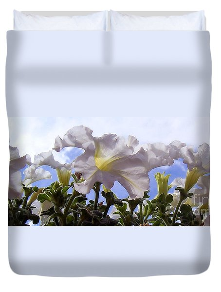 Duvet Cover featuring the photograph Petunia Sky by Janice Westerberg