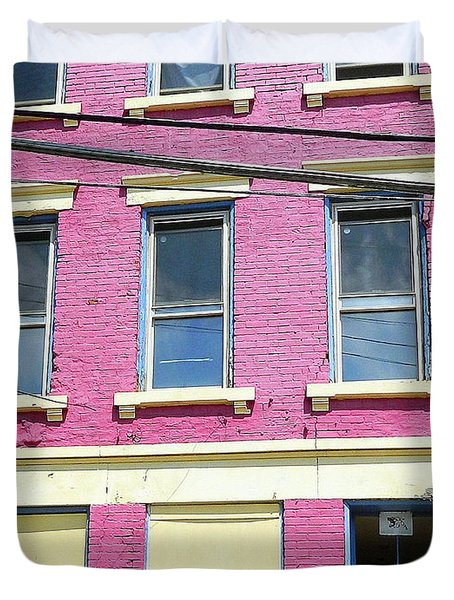 Duvet Cover featuring the photograph Pink Yellow Blue Building by Kathy Barney