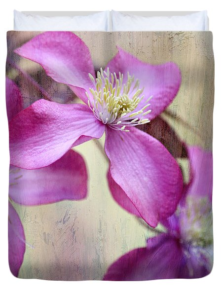Duvet Cover featuring the photograph Purple Clematis With Textures by Sylvia Cook