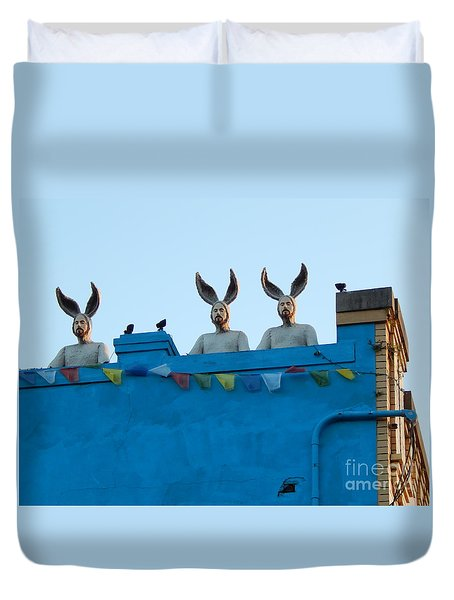 Duvet Cover featuring the photograph Rabbit People On A Roof In New Orleans Louisiana #1 by Michael Hoard