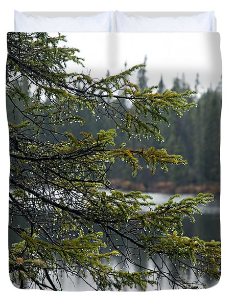Raindrops On An Evergreen Duvet Cover by Larry Ricker