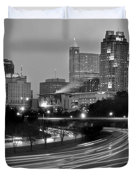 Duvet Cover featuring the photograph Raleigh Skyline At Dusk Evening Black And White Bw Evening Panorama North Carolina Nc by Jon Holiday