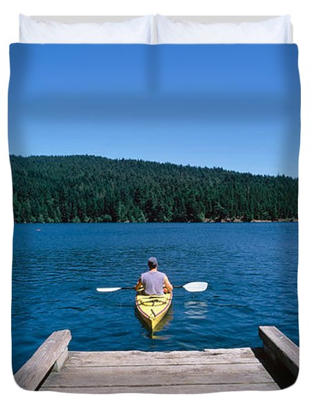 Rear View Of A Man On A Kayak Duvet Cover