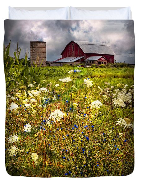 Red Barns In The Wildflowers Duvet Cover by Debra and Dave Vanderlaan