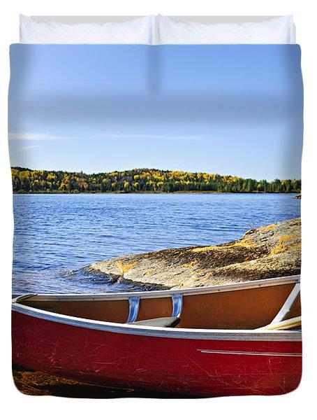 Red Canoe On Shore Duvet Cover