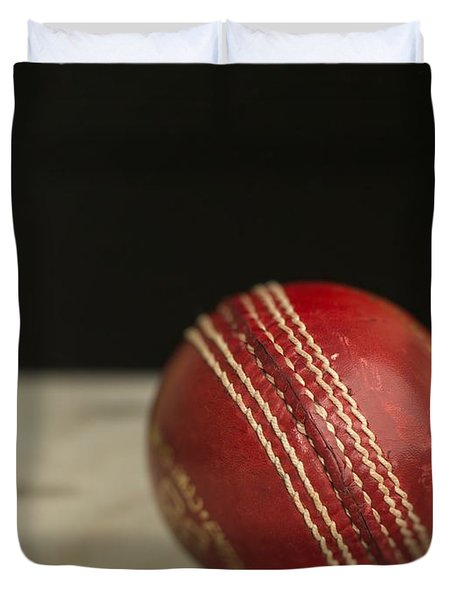 Red Cricket Ball Duvet Cover by Edward Fielding