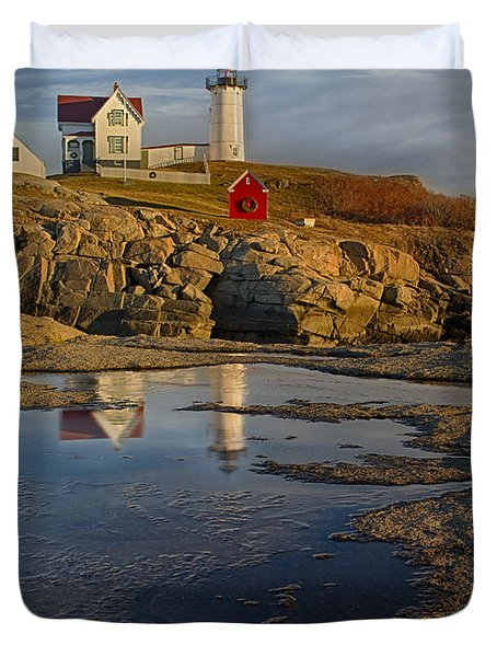 Reflecting On Nubble Lighthouse Duvet Cover by Susan Candelario