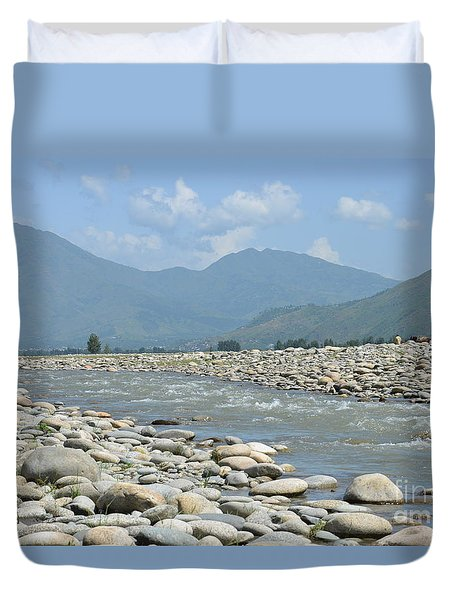 Riverbank Water Rocks Mountains And A Horseman Swat Valley Pakistan Duvet Cover by Imran Ahmed