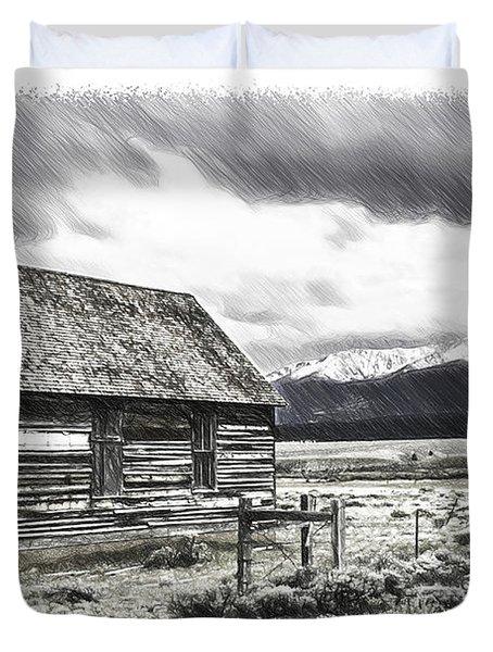 Rocky Mountain Past Duvet Cover by John Haldane