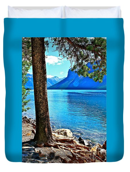 Duvet Cover featuring the photograph Rooted In Lake Minnewanka by Linda Bianic
