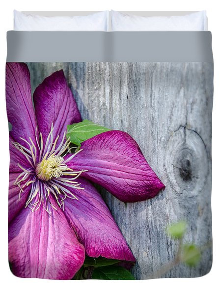 Duvet Cover featuring the photograph Rustic Clematis by Susan  McMenamin