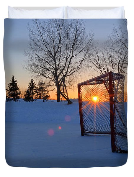 Scoring The Sunset Duvet Cover by Darcy Michaelchuk