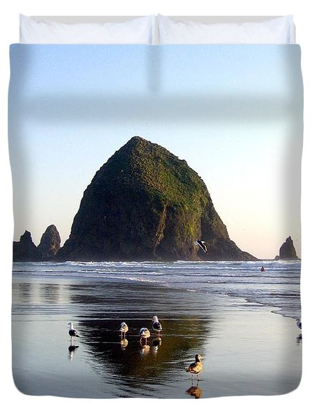 Seagulls And A Surfer Duvet Cover by Will Borden
