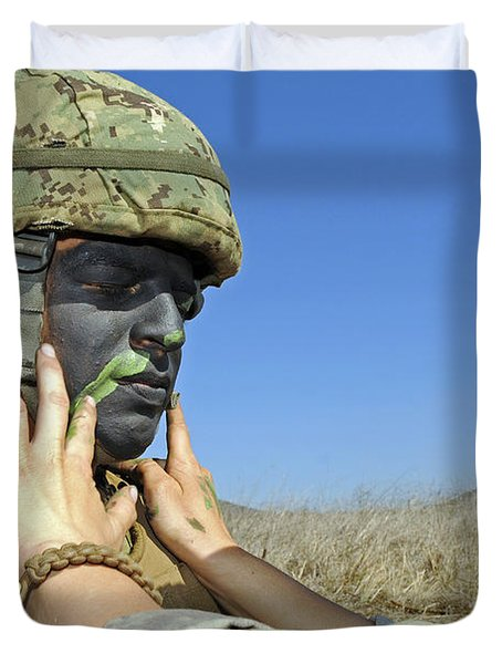 Seaman Has His Face Painted To Help Duvet Cover by Stocktrek Images