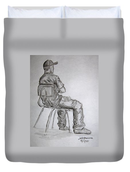 Seated Man In Ball Cap Duvet Cover by Jeffrey Oleniacz