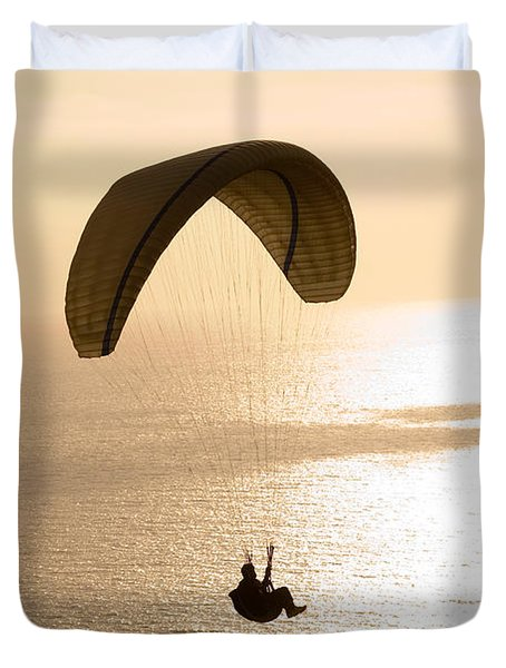 Silhouette Of A Paraglider Flying Duvet Cover