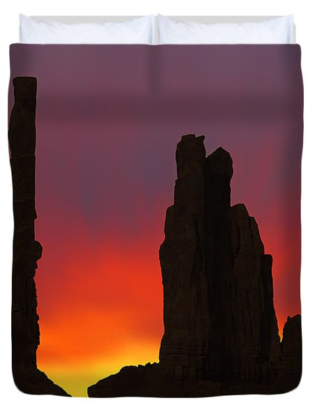 Silhouette Of Totem Pole After Sunset - Monument Valley Duvet Cover by Mike McGlothlen