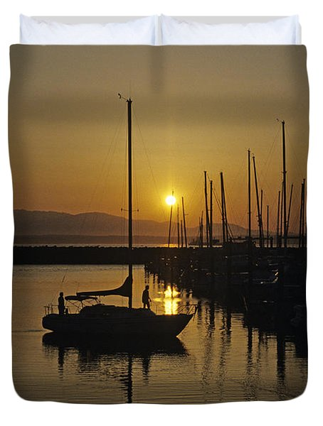 Silhouetted Man On Sailboat Duvet Cover