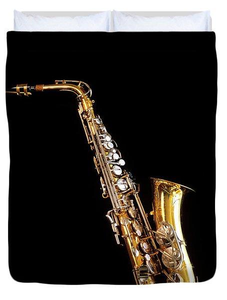 Single Saxophone Against Black Duvet Cover