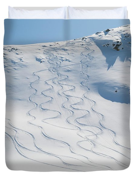 Ski Tracks In The Snow On A Mountain Duvet Cover by Keith Levit