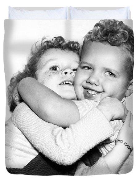 Small Boy Hugging His Sister Duvet Cover