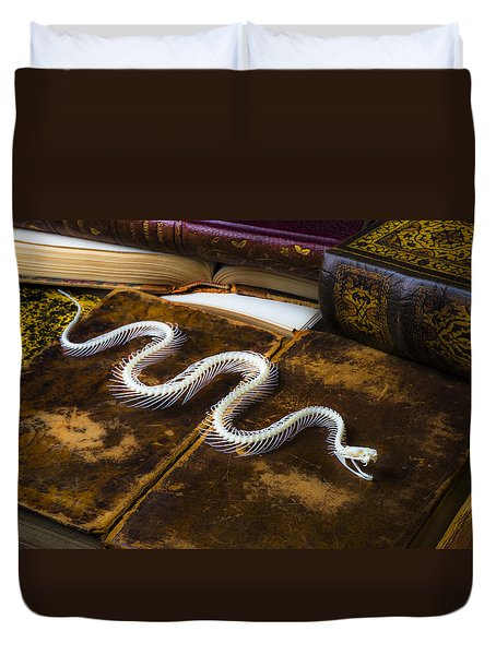 Snake Skeleton And Old Books Duvet Cover by Garry Gay
