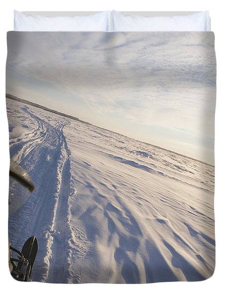 Snowmachiner Following Trail On Frozen Duvet Cover by Kevin Smith