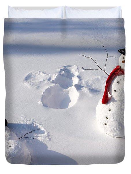 Snowmen In Forest Making Snow Angel Duvet Cover
