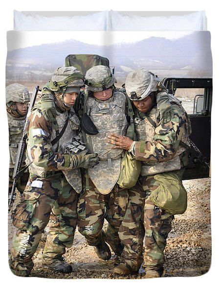Soldiers Conduct Medical Evacuation Duvet Cover by Stocktrek Images