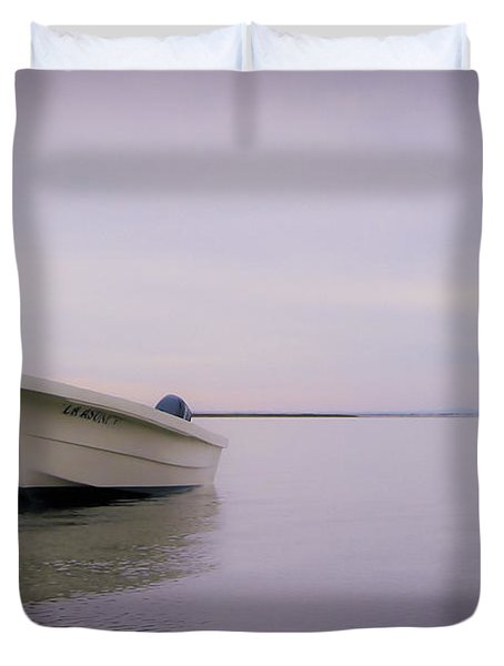 Solitary Boat Duvet Cover by Adam Romanowicz