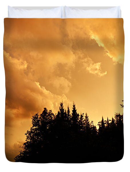 Storm Clouds At Sunset Duvet Cover by Larry Ricker