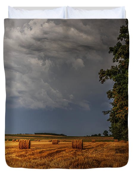 Storm Clouds Over Harvested Field In Poland Duvet Cover