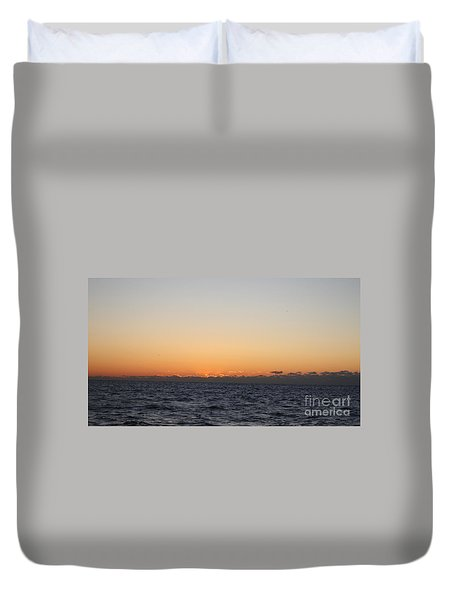 Sun Rising Above Clouds And Horizon Duvet Cover by John Telfer