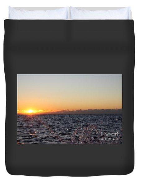 Sun Rising Through Clouds In Rough Waters Duvet Cover by John Telfer