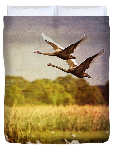 Swans In Flight Duvet Cover