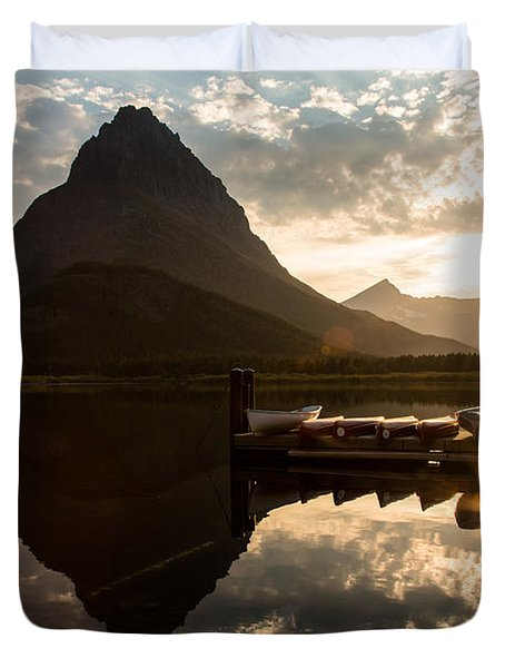 Swiftcurrent Lake Boats Reflection And Flare Duvet Cover