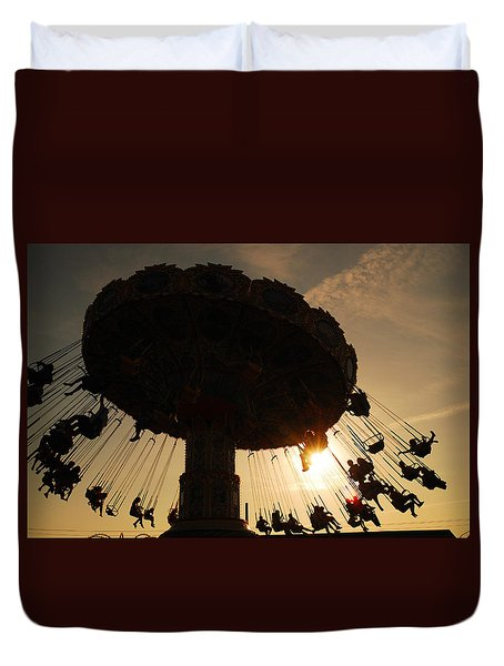 Duvet Cover featuring the photograph Swing Ride At Sunset by James Kirkikis