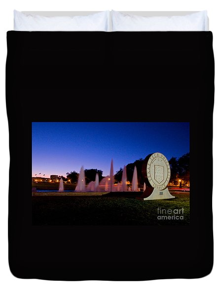 Duvet Cover featuring the photograph Texas Tech University Seal And Blue Sky by Mae Wertz
