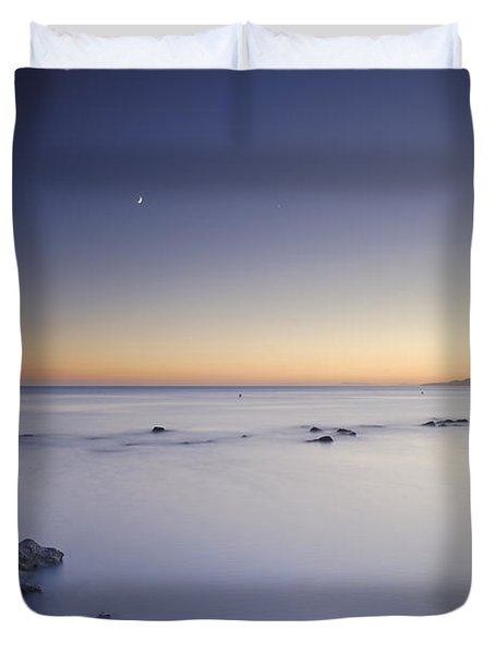 the Moon over the sea Duvet Cover by Guido Montanes Castillo