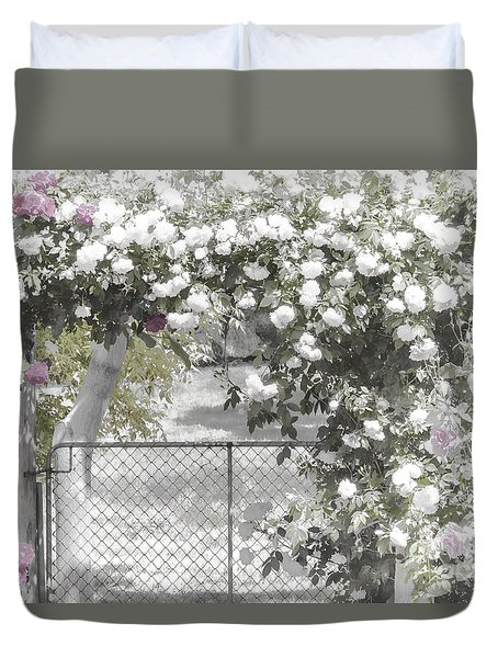 Duvet Cover featuring the photograph The Rose Arbor by Elaine Teague