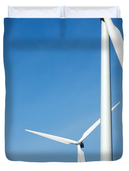 Three Mighty Windmills In A Row Against A Blue Sky. Duvet Cover
