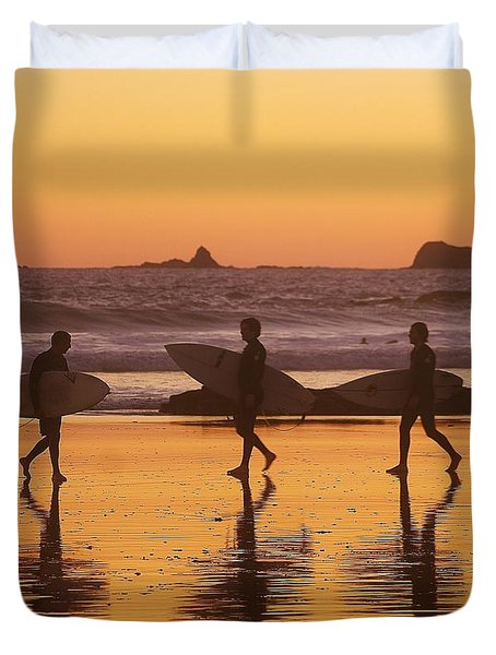 Three Surfers At Sunset Duvet Cover