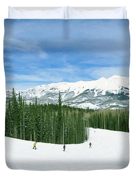 Tourists Skiing On A Snow Covered Duvet Cover