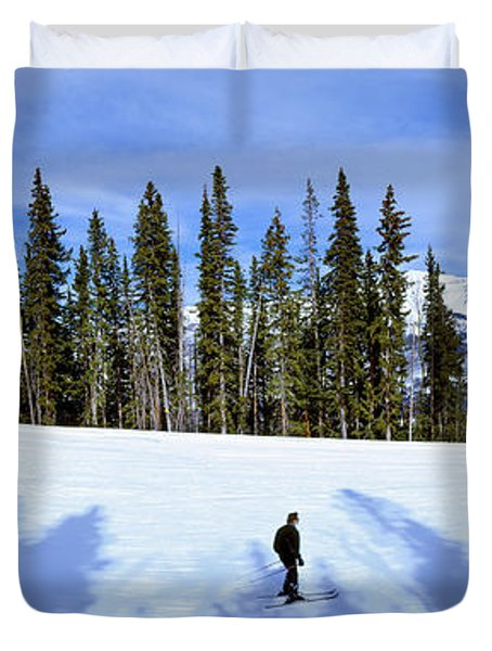 Tourists Skiing On Snow Covered Duvet Cover
