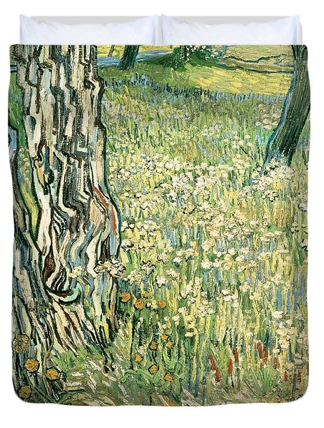Tree Trunks In Grass Duvet Cover by Vincent van Gogh