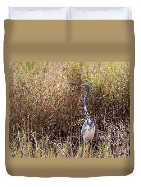 Duvet Cover featuring the photograph Tricolored Heron Peeping Over The Rushes by John M Bailey