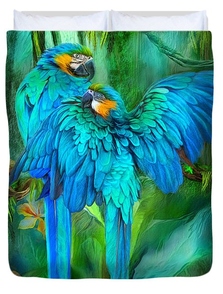 Duvet Cover featuring the mixed media Tropic Spirits - Gold And Blue Macaws by Carol Cavalaris