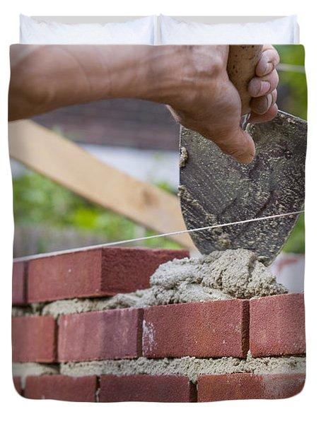 Trowel Spreading Cement On Bricks Duvet Cover